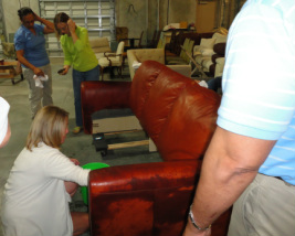 Technicians repairing leather sofa